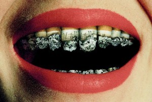 Our Waterloo, ON area patients know that smoking can prevent them from receiving dental implants.